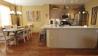 Separate dining area gives you plenty of space for dining.  Countertop bar!