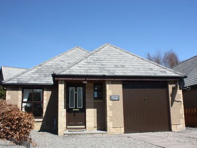 Photo for Ideal Family holiday bungalow in Aviemore with secure garage and off road parking