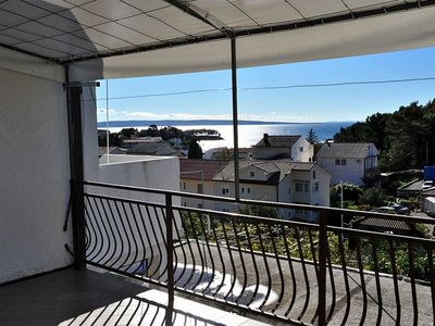 Photo for Two bedroom apartment with terrace and sea view Rab (A-14427-a)