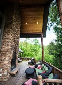 Enjoy hours of outdoor fun by my massive 31' covered wood fireplace