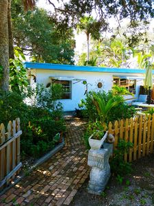Photo for Tropical Riverfront Cottage -  Private. Walk 400 yds. to Beach! Ideally Located.