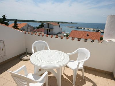 Photo for Two bedroom apartment with terrace and sea view Novalja, Pag (A-6583-c)