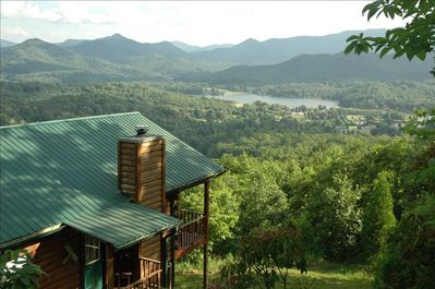 Secluded lake, mountain, sunset view, hot tub, pet friendly cabin. Paved road