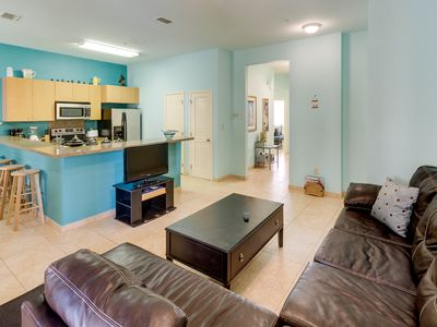 Photo for New Listing! modern condo with shared pool & hot tub, 5 minute walk to beach!