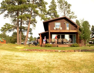 Photo for Cozy Log Cabin on the Lake
