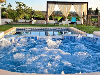 Photo for Can Butxaqui villa near the sea with jacuzzi and swimming pool 160