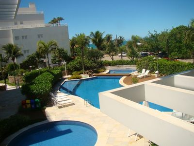 Photo for Apartment 4 suites 50 m from the sea in Jurerê Internacional