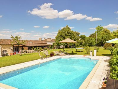Photo for Traditional farmhouse with pool in the middle of the French countryside.