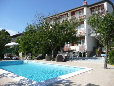 Photo for Holiday apartment with pool in quiet location