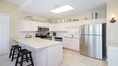 Kitchen with Corian Counters and Stainless Steel Appliances