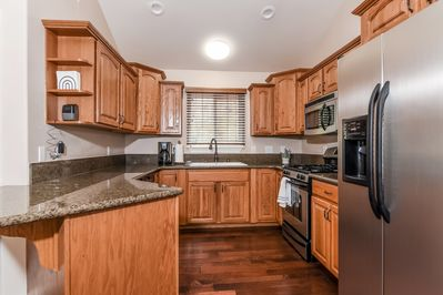 Open Concept Kitchen With GE Appliances