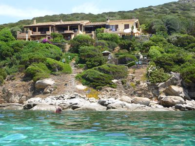 Photo for Sardinia Villasimius water front Villa, at only 25 mt from the sea, with garden and an amazing view over: the bay, the Cala Caterina beach and sunset