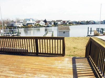Spacious, comfortable 4 bedroom house with free WiFi, pier boat-docking, and a great view of the canal located uptown on the bayside just a few blocks to the beach!