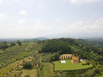 Photo for A really unique villa on the hills 7 Kms northeast of Lucca with stunning views