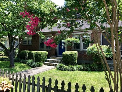 Photo for Clean & Cozy cottage in historic neighborhood. Fenced yard for pets!
