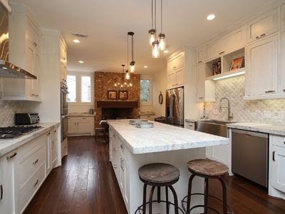 Beautiful gourmet island kitchen with bar seating, stainless steel appliances