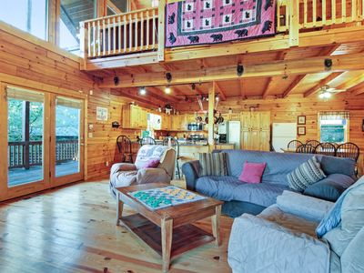 Photo for Dog-friendly waterfront cabin w/ private hot tub, pool table & dock!