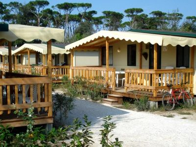 Photo for Beautiful chalet in cozy campsite 800 m from the sea!
