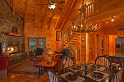 Cozy Living Room featuring All-Wood Interior, Open Floor Plan, and Dining Area