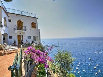 Photo for Villa Passione: A splendid and luminous two-story villa built sheer above the sea, with Free WI-FI.
