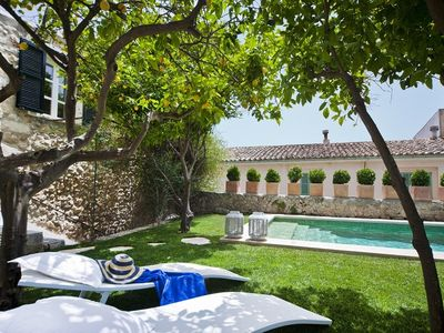 Photo for Luxury townhouse with garden and heated pool.