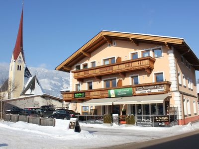 Photo for Stylish apartment in the center, with the ski bus to Fügen in front of the door