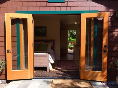 Front Entrance, Double french doors. Side washer/dryer hut.