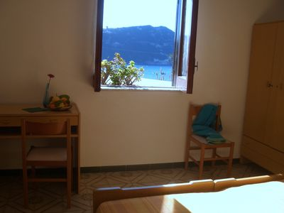 Photo for Comfortable studio room with sea view, very close to the beach