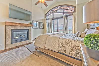 "Upper Level Master Bedroom with a King Bed, Gas Fireplaces, 50"" HD Smart TV, Full Private Bath, and Private Deck with Beautiful Views"