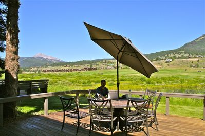 Back porch over looking the Gallatin River, Lone Peak Mountain & Golf course.