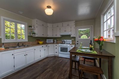 Cooking is delightful in this fully stocked kitchen with cafe style dining table.