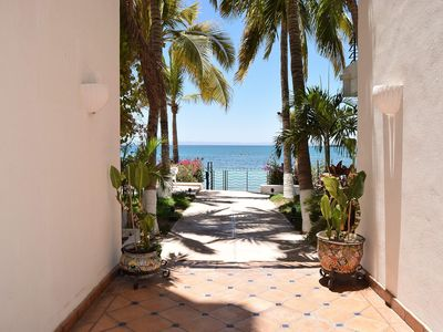 Photo for Prime BEACHFRONT condo with pool & jacuzzi