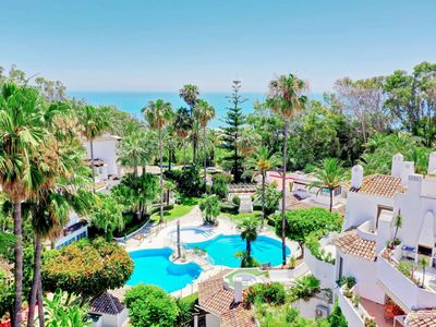 Photo for Beach front duplex Penthouse, panorama view, 3 pools, wifi, Roof Terrace