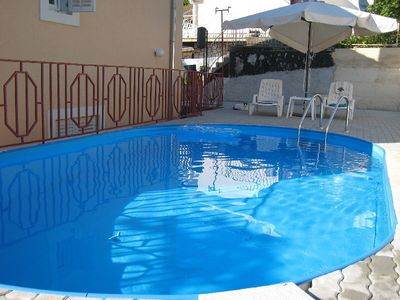 Photo for Holiday apartment with pool, washing machine and air conditioning
