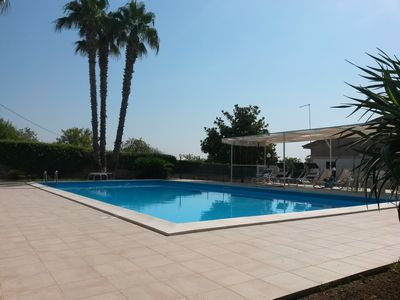 Pool. bath floor with sun loungers and deck chairs