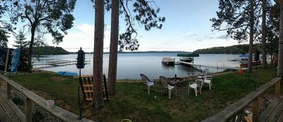 Panoramic view of lake from deck in front of cabin