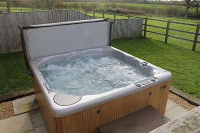 Exclusive use of your own hot tub with countryside view.