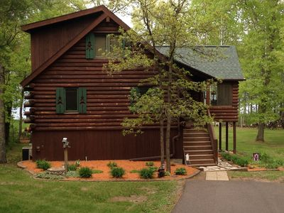 Photo for Perfect Log Cabin Getaway- Level elevation,  sandy lake frontage, pontoon incl.