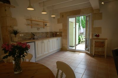 The kitchen has doors on to your private garden.