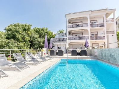 Photo for Enjoy apartment with sea view and pool on the Kvarner bay.