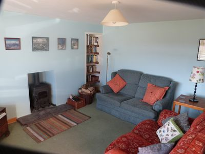 Comfortable and cosy lounge with log burner