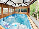 Hot tub - Relax in your own private, covered hot tub.
