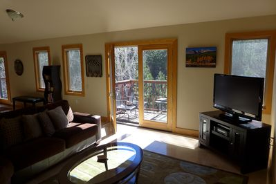 Mountain comfort!  Take a seat and listen to the river, visit, read or watch TV!