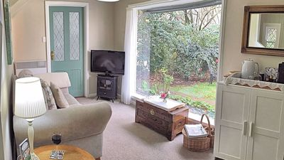 The sitting room looks out onto a private garden area where parrots feed.