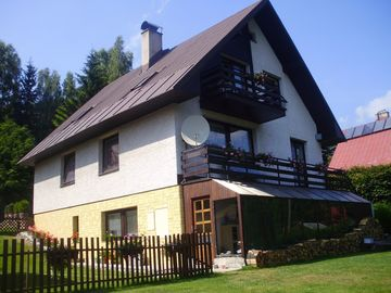 Holiday house with garden and outdoor swimming pool