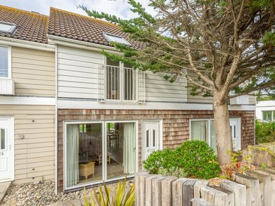 Photo for This two-storey, two-bedroom house is very well situated to enjoy West Bay.