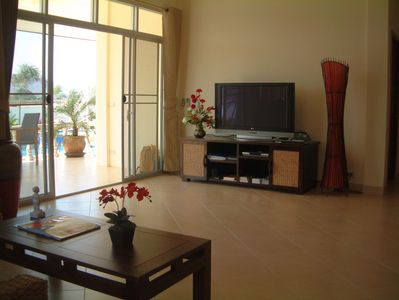Spacious living room with ample space for more than 1 wheelchair.