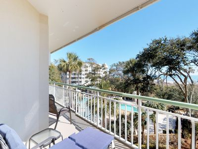 Photo for Oceanfront corner condo with private balcony, shared pools & hot tub