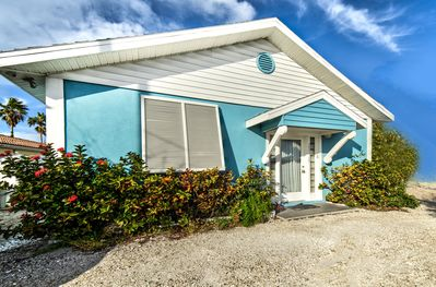 Exterior of our beautiful Private waterfront Beach Cottage