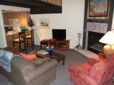 Relax by the fire or in front of the TV in our cozy living room